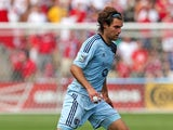 Graham Zusi #8 of Sporting Kansas City controls the ball against the Chicago Fire during an MLS match at Toyota Park on July 7, 2013