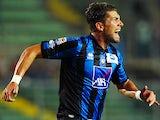 Atalanta 's Guglielmo Stendardo celebrates after scoring the opening goal against Torino on September 1, 2013