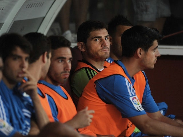 Real Madrid 'keeper Iker Casillas looks frustrated on the bench during a game with Grenada on August 26, 2013