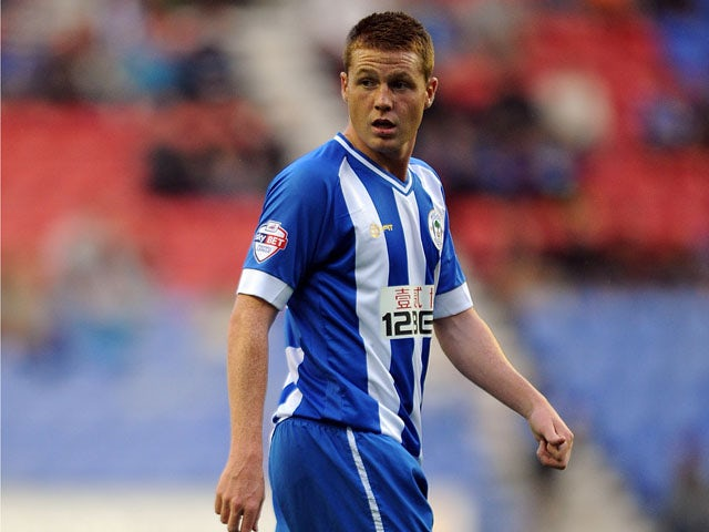 James McCarthy of Wigan Athletic looks on during the Sky Bet Championship match between Wigan Athletic and Doncaster Rovers at DW Stadium on August 20, 2013