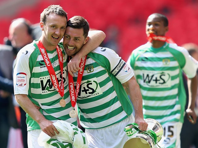 James McAllister the captain of Yeovil Town celebrates victory with team mate Gavin Williams during the NPower League One play off final between Brentford and Yeovil Town at Wembley Stadium on May 19, 2013