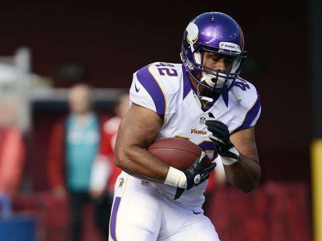 Jerome Felton #42 of the Minnesota Vikings runs with the ball in pre-game warmups before an NFL pre-season football game against the San Francisco 49ers at Candlestick Park on August 10, 2012