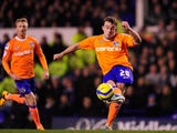 Oldham player Jose Baxter curls a shot against the woodwork during the FA Cup Fifth Round Replay between Everton and Oldham Athletic at Goodison Park on February 26, 2013