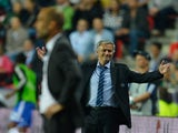 Chelsea boss Jose Mourinho appeals the sending off of Ramires against Bayern on August 30, 2013