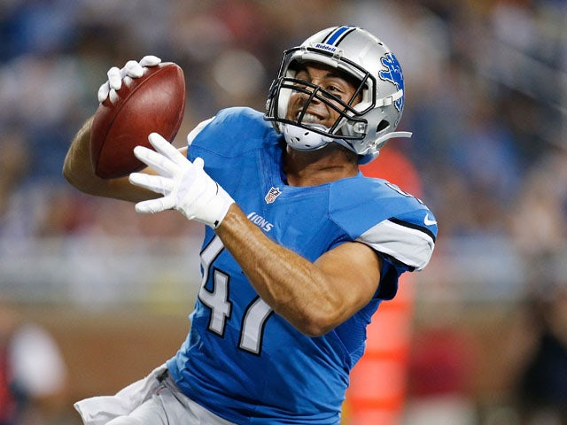Joseph Fauria #47 of the Detroit Lions celebrates after scoring a third quarter touchdown while playing the New England Patriots during a pre season game at Ford Field on August 22, 2013