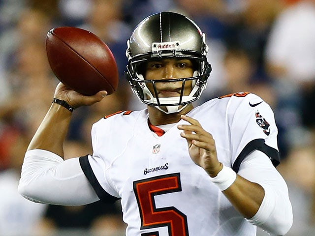 Josh Freeman #5 of the Tampa Bay Buccaneers throws a pass against the New England Patriots during the game at Gillette Stadium on August 16, 2013