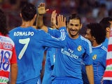 Real's Karim Benzema celebrates with Cristiano Ronaldo after a goal against Grenada on August 26, 2013