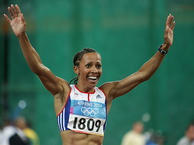 Great Britain's Kelly Holmes celebrates after winning gold in the women's 800 metre final during the Olympic Games in Athens on August 24, 2004