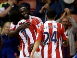 Stoke players congratulate Kenwyne Jones following a goal against Walsall on August 28, 2013