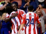 Stoke players congratulate Kenwyne Jones following a goal against Walsall on August 28, 2013