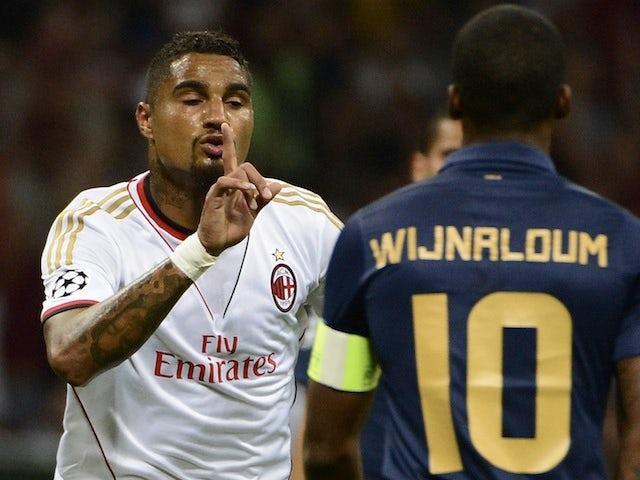 Milan's Kevin Prince Boateng taunts PSV captain George Wijnaldum after a goal on August 28, 2013