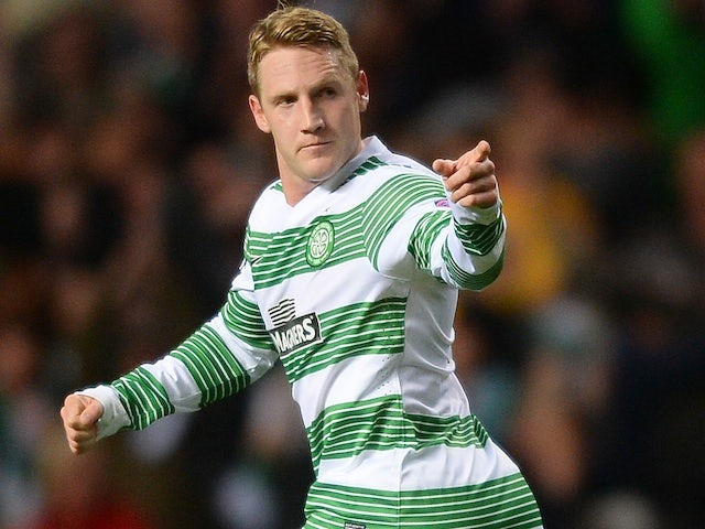 Celtic midfielder Kris Commons celebrates after a goal against Shakhtar Karagandy on August 28, 2013