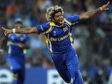 Sri Lanka fast bowler Lasith Malinga reacts after taking the wicket of India batsman Sachin Tendulkar during the ICC Cricket World Cup Final on April 2, 2011