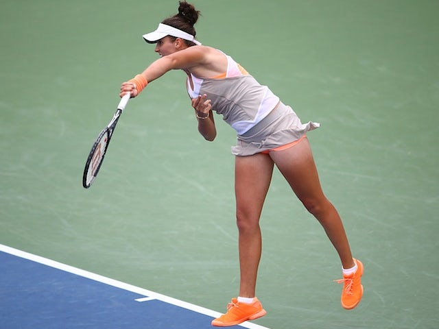 Laura Robson serves during a match at the Southern California Open on July 31, 2013