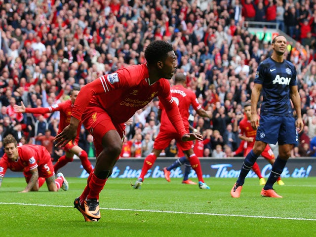 Daniel Sturridge of Liverpool celebrates scoring the opening goal during the Barclays Premier League match between Liverpool and Manchester United at Anfield on September 01, 2013