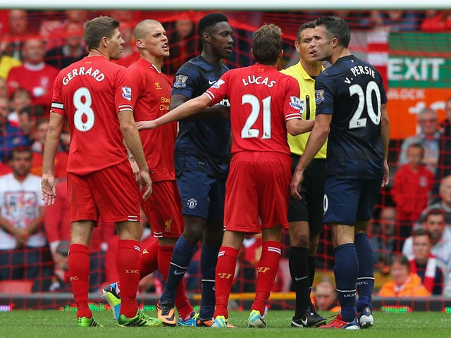 Steven Gerrard of Liverpool exchanges words with Robin van Persie of Manchester United during the Barclays Premier League match between Liverpool and Manchester United at Anfield on September 01, 2013