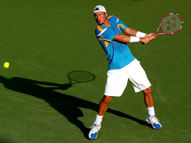 Lleyton Hewitt of Australia returns a shot to Ryan Harrison during the Citi Open at the William H.G. FitzGerald Tennis Center on July 30, 2013