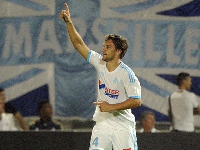 Marseille's Lucas Mendes celebrates after scoring the opening goal against Monaco on September 1, 2013