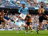 Manchester City's English defender Joleon Lescott heads the ball during the English Premier League football match between Manchester City and Hull City at the Etihad Stadium in Manchester, northwest England, on August 31, 2013