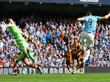 Alvaro Negredo of Manchester City scores the opening goal past Allan McGregor of Hull City during the Barclays Premier League match between Manchester City and Hull City at the Etihad Stadium on August 31, 2013