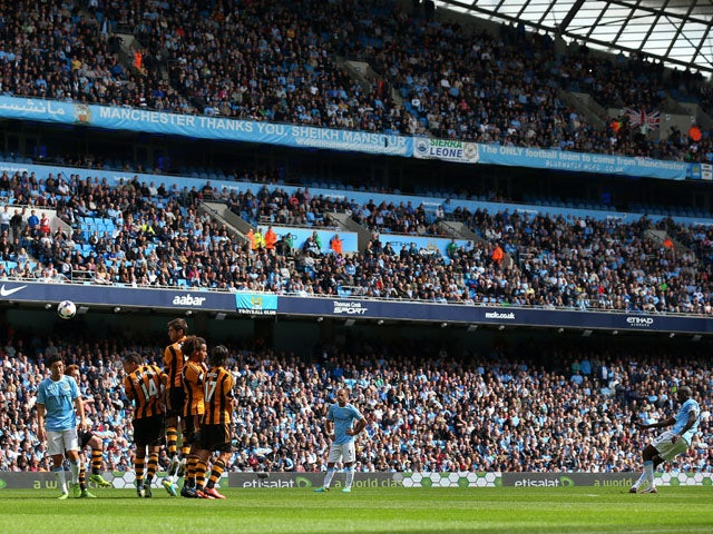 Yaya Toure of Manchester City scores the second goal from a free kick during the Barclays Premier League match between Manchester City and Hull City at the Etihad Stadium on August 31, 2013