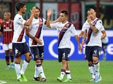 Cagliari's Marco Sau celebrates his goal with team mates during the match against AC Milan on September 1, 2013