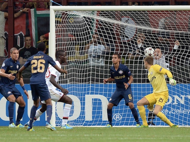 Milan striker Mario Balotelli scores against PSV Eindhoven on August 28, 2013