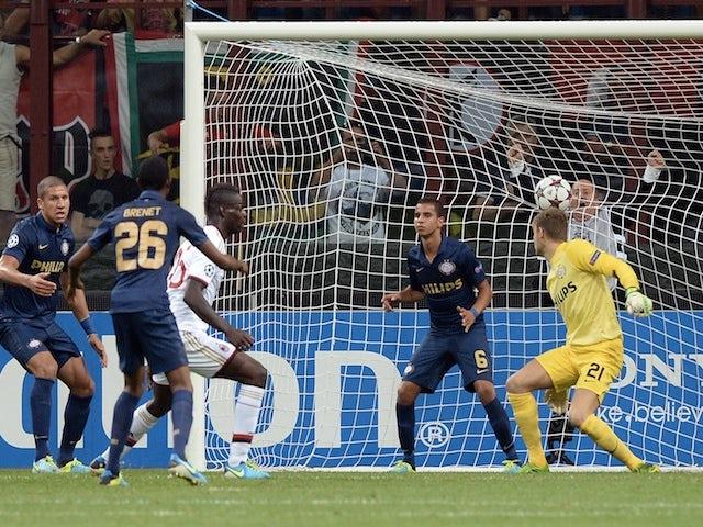 Milan striker Mario Balotelli scores against PSV Eindhoven on August 28, 2013
