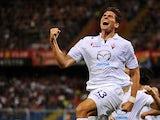 Fiorentina's Mario Gomez celebrates after scoring his team's third goal against Genoa on September 1, 2013