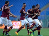 Roma's Miralem Pjanic is congratulated by team mates after scoring his team's second goal against Hellas Verona on September 1, 2013