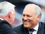 Fulham manager Martin Jol is greeted by Newcastle United manager Alan Pardew during the Barclays Premier League match between Newcastle United and Fulham at St James' Park on August 31, 2013