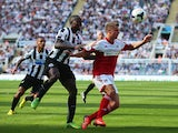 Mapou Yanga-Mbiwa of Newcastle United challenges for the ball with Alex Kacaniklic of Fulham during the Barclays Premier League match between Newcastle United and Fulham at St James' Park on August 31, 2013