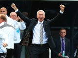 Newcastle United manager Alan Pardew celebrates as his side scores during the Barclays Premier League match between Newcastle United and Fulham at St James' Park on August 31, 2013