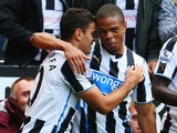 Hatem Ben Arfa of Newcastle United celebrates scoring the opening goal with team mate Loic Remy during the Barclays Premier League match between Newcastle United and Fulham at St James' Park on August 31, 2013
