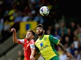 Bradley Johnson of Norwich City battles with Alan Lallana of Southampton during the Barclays Premier League match between Norwich City and Southampton at Carrow Road on August 31, 2013