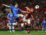 Chelsea's Oscar vies for the ball with Nemanja Vidic on August 26, 2013