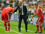 Bayern boss Pep Guardiola instructs his players during the European Super Cup with Chelsea on August 30, 2013