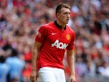 Phil Jones of Manchester United in action during the FA Community Shield match between Manchester United and Wigan Athletic at Wembley Stadium on August 11, 2013