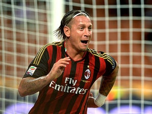 Milan's Philippe Mexes celebrates after scoring his team's second goal against Cagliari on September 1, 2013