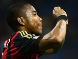 Milan's Robinho celebrates after scoring the opening goal against Cagliari on September 1, 2013