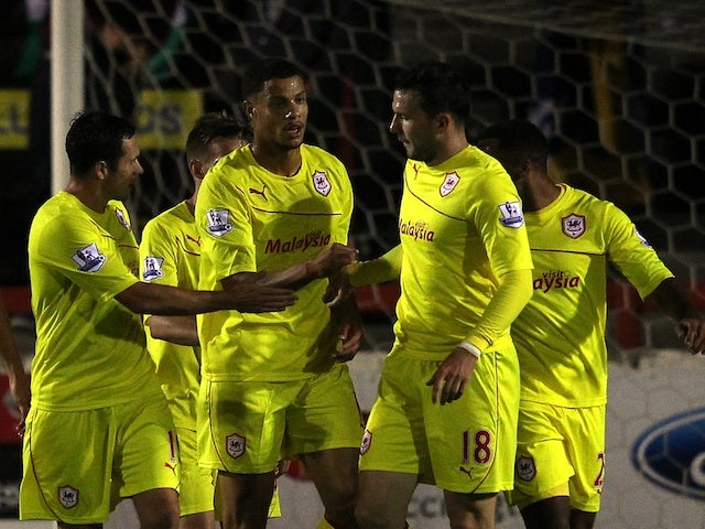 Cardiff players congratulate Rudy Gestede after his goal against Accrington Stanley on August 28, 2013