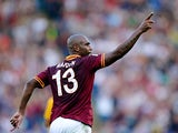 Roma's Sisenando Douglas Maicon celebrates his team's opening goal against Hellas Verona on September 1, 2013