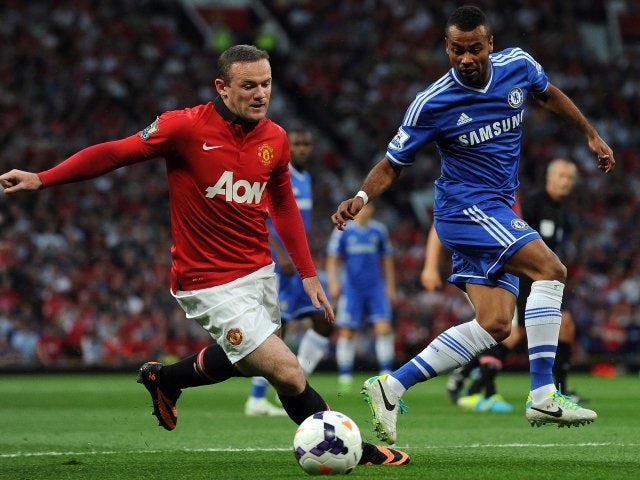 Wayne Rooney and Ashley Cole battle for possession.