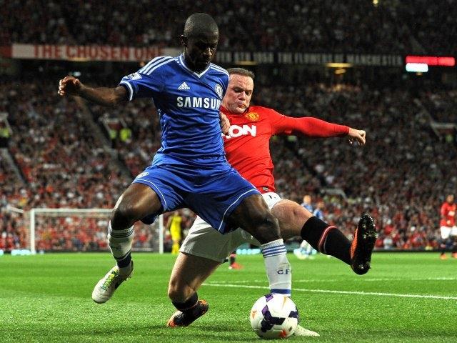 Wayne Rooney performs a slide tackle on Ramires.
