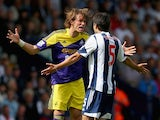 Miguel Michu of Swansea clashes with Claudio Yacob of West Brom during the Barclays Premier League match between West Bromwich Albion and Swansea City at The Hawthorns on September 01, 2013