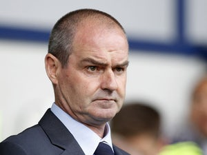 West Bromwich Albion's Scottish manager Steve Clarke awaits kick off in the English Premier League football match between West Bromwich Albion and Swansea City at The Hawthorns in West Bromwich, central England, on September 1, 2013