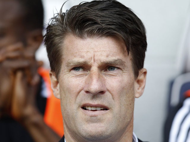 Swansea City's Danish manager Michael Laudrup awaits kick off in the English Premier League football match between West Bromwich Albion and Swansea City at The Hawthorns in West Bromwich, central England, on September 1, 2013