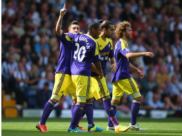 Pablo Hernandez of Swansea celebrates with team mates after scoring their second goal during the Barclays Premier League match between West Bromwich Albion and Swansea City at The Hawthorns on September 01, 2013