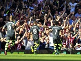 Stoke City's English midfielder Jermaine Pennant celebrates scoring his goal with supporters during the English Premier League football match against West Ham United at the Boleyn Ground, Upton Park, in East London, England, on August 31, 2013