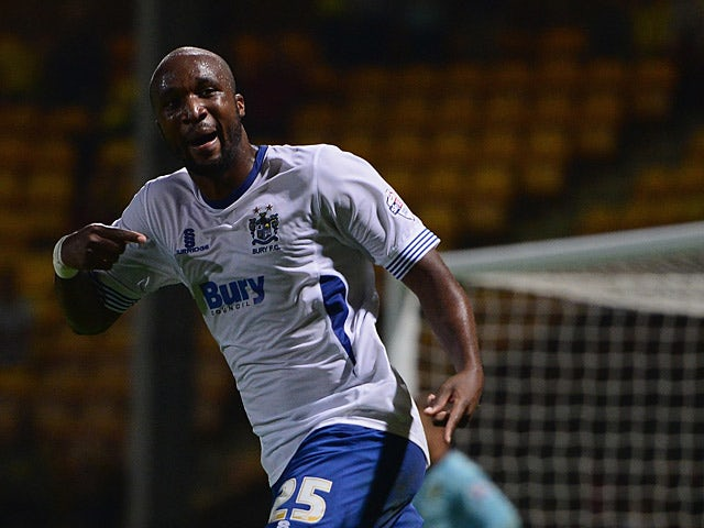 Bury's William Edjenguele celebrates his goal against Norwich during their League Cup match on August 27, 2013
